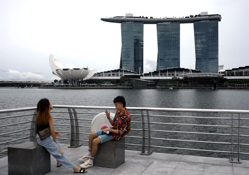 Youth takes photos at Merlion Park in Singapore