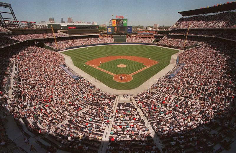 FILE - In this March 29, 1997 file photo, fans fill the stands as the Atlanta Braves play an exhibition game against the New York Yankess in the first baseball game ever played at Turner Field in Atlanta. The Atlanta Braves are leaving Turner Field and moving into a new 42,000-seat, $672 million stadium complex in Cobb County in 2017. Braves executives John Schuerholz, Mike Plant and Derek Schiller said Monday, Nov. 11, 2013, that the team decided not to seek another 20-year lease at Turner Field and began talks with the Cobb Marietta Coliseum and Exhibit Hall Authority in July.(AP Photo/Ric Feld, File)