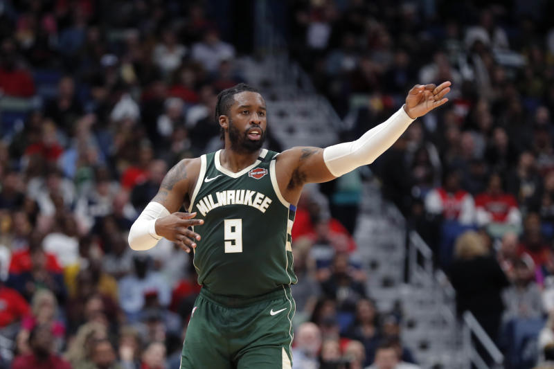 Milwaukee Bucks guard Wesley Matthews (9) reacts after making a 3-point shot in the second half of an NBA basketball game against the New Orleans Pelicans in New Orleans, Tuesday, Feb. 4, 2020. The Bucks won 120-108. (AP Photo/Gerald Herbert)