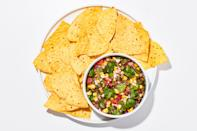 "Whether it's scooped up with tortilla chips or spooned over a simple fillet of fish, this zippy charred corn salsa is the ultimate peak-August condiment. <a href=""https://www.bonappetit.com/recipe/corn-salsa?mbid=synd_yahoo_rss"" rel=""nofollow noopener"" target=""_blank"" data-ylk=""slk:See recipe."" class=""link rapid-noclick-resp"">See recipe.</a>"
