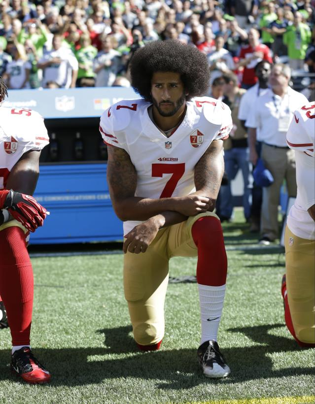 In this Sept. 25, 2016, file photo, San Francisco 49ers' Colin Kaepernick kneels during the national anthem before an NFL football game against the Seattle Seahawks, in Seattle. (AP Photo/Ted S. Warren, File)