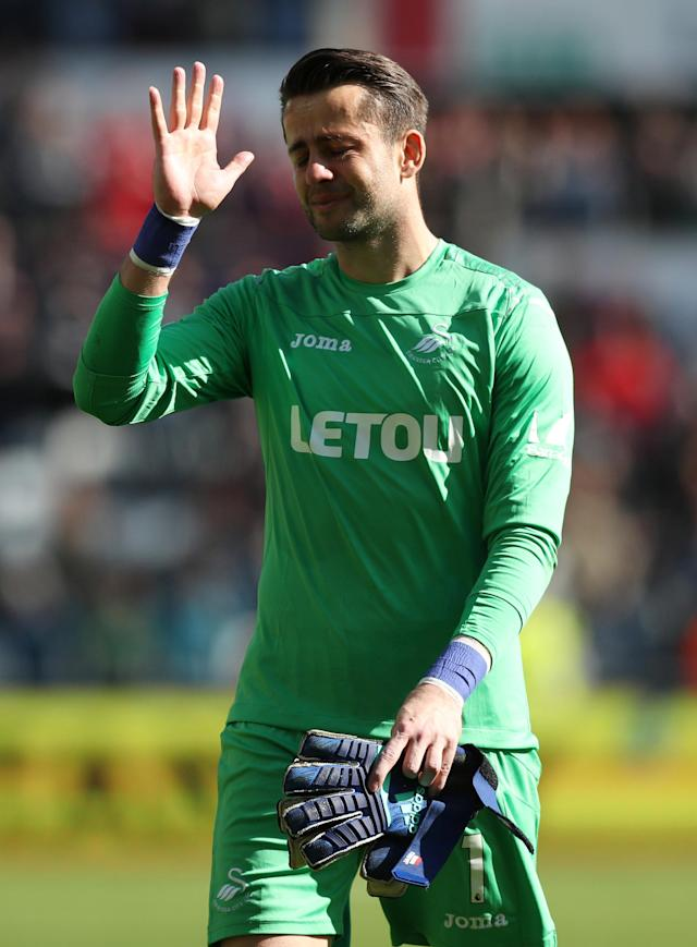 "Soccer Football - Premier League - Swansea City vs Stoke City - Liberty Stadium, Swansea, Britain - May 13, 2018 Swansea City's Lukasz Fabianski salutes their fans after the match as they are relegated from the Premier League Action Images via Reuters/Peter Cziborra EDITORIAL USE ONLY. No use with unauthorized audio, video, data, fixture lists, club/league logos or ""live"" services. Online in-match use limited to 75 images, no video emulation. No use in betting, games or single club/league/player publications. Please contact your account representative for further details."