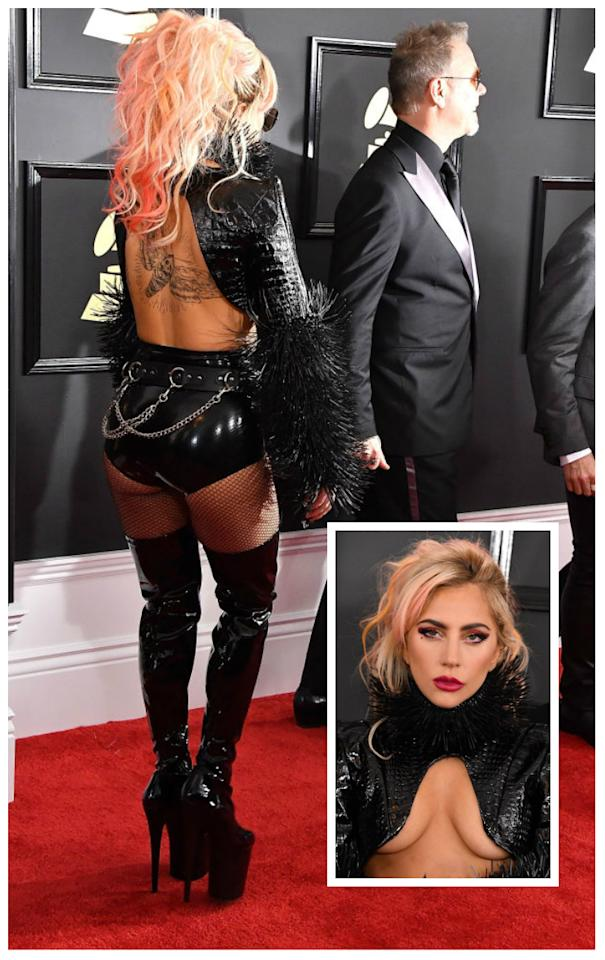 <p>The outlandish performer just keeps on giving with this cheeky get-up. Not many people can get away with latex, high-boots and fishnets without offending the masses. <i>(Getty)</i> </p>