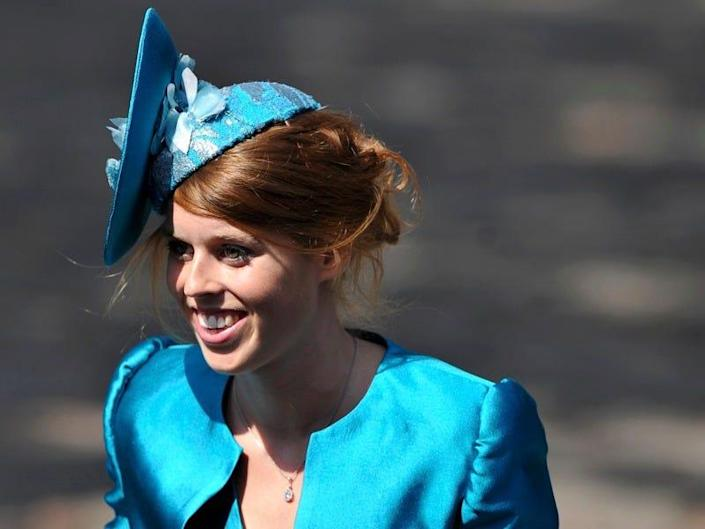 Princess Beatrice wears a turquoise jacket and fascinator.