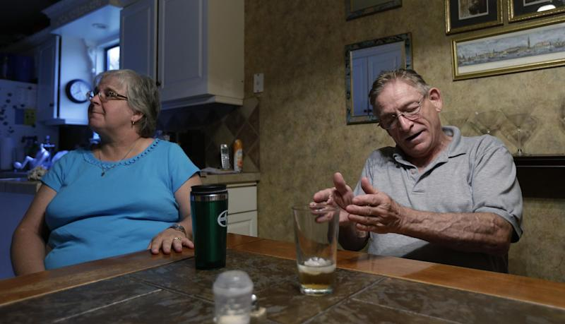 In this June 21, 2013, photo, Phillip Baker, right, and his sister-in-law, Lisa Conn, talk about his late wife Debra Masters Baker in Austin, Texas. Debra Masters Baker was killed in her home Jan. 13, 1988. Her slaying remains unsolved but the family believes it might never have occurred had authorities not focused on the wrong man in a similar killing 17 months earlier. (AP Photo/Eric Gay)