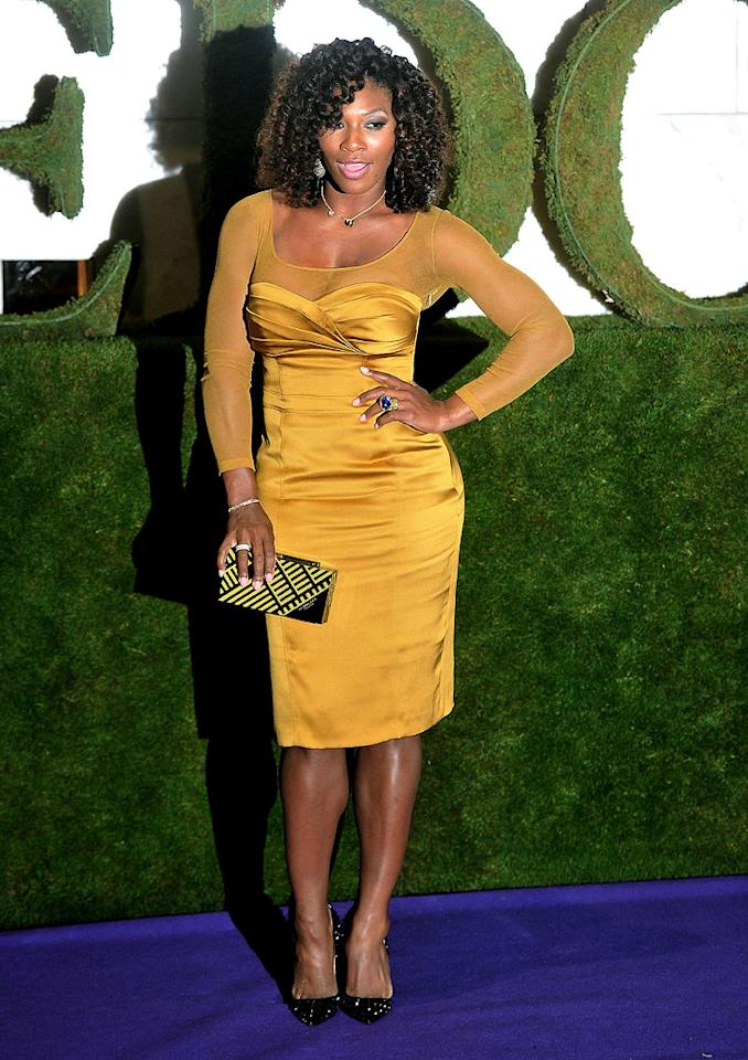 After winning Wimbledon for the fifth time, Serena Williams strutted her stuff at the Champions Ball in London on Sunday evening. The tennis ace showed off her bulging biceps and sexy curves in this mustard-colored Burberry frock. On her feet ... her favorite pair of spiked Christian Louboutin pumps. (7/8/2012)