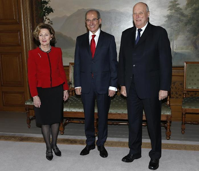 Norway's King Harald, right, and Queen Sonja receive Ahmet Uzumcu, director general of OPCW at the Royal Palace. in Oslo Tuesday Dec. 10, 2013. The OPCW are to receive the 2013 Peace Nobel Prize later Tuesday, with the prize attributed to its extensive efforts to eliminate chemical weapons. (AP Photo/Erik Johansen / NTB scanpix) NORWAY OUT