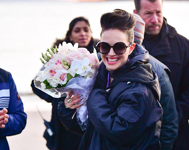 <p>Which is more gorgeous: Natalie Portman's smile or the bouquet of flowers she's carrying? The actress received the arrangement on Monday the set of her new film <em>Vox Lux, </em>currently in production at Plumb Beach in Brooklyn, New York. (Photo: James Devaney/GC Images) </p>