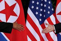 U.S. President Donald Trump and North Korea's leader Kim Jong Un meet at the start of their summit at the Capella Hotel on the resort island of Sentosa, Singapore June 12, 2018. Picture taken June 12, 2018. REUTERS/Jonathan Ernst/Files
