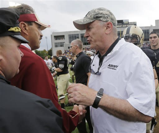 Boston College head coach Frank Spaziani, left, and Army head coach Rich Ellerson shake hands after their NCAA college football game Saturday, Oct. 6, 2012, in West Point, N.Y. Army won, 34-31. (AP Photo/Mike Groll)