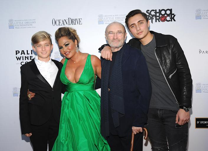 MIAMI BEACH, FL - NOVEMBER 15: (L-R) Matthew Collins, Orianne Cevey, Phil Collins and Nicholas Collins attend the 4th Annual Dreaming on the Beach Gala at Fillmore Miami Beach on November 15, 2018 in Miami Beach, Florida. (Photo by Desiree Navarro/Getty Images)