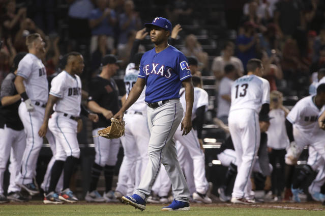 Texas Rangers relief pitcher Jose Leclerc walks off the field after giving up a walk-off, two-run home run to Arizona Diamondbacks' Jarrod Dyson in a baseball game Tuesday, April 9, 2019, in Phoenix. The Diamondbacks won 5-4. (AP Photo/Ross D. Franklin)