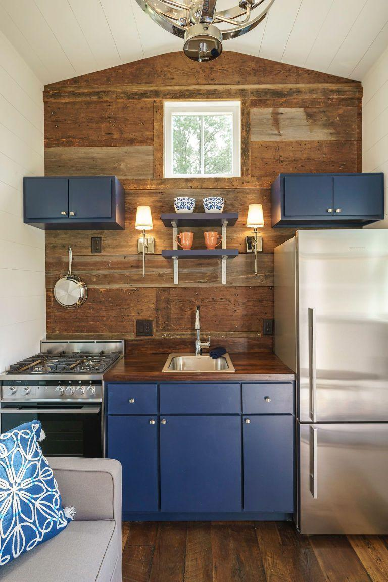 """<p>This 280-square-foot tiny house is here to prove anyone who claims you can't use dark colors in a small room wrong. Instead of going light and airy, the Indigo Tiny Home by <a class=""""link rapid-noclick-resp"""" href=""""http://www.driftwoodhomesusa.com/"""" rel=""""nofollow noopener"""" target=""""_blank"""" data-ylk=""""slk:Driftwood Homes USA"""">Driftwood Homes USA</a> is decorated with pops of dark, moody colors.</p><p><a class=""""link rapid-noclick-resp"""" href=""""https://www.countryliving.com/home-design/news/a38779/indigo-tiny-house/"""" rel=""""nofollow noopener"""" target=""""_blank"""" data-ylk=""""slk:SEE INSIDE"""">SEE INSIDE</a></p>"""