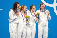 """<p>Biography: Schmitt is 31, Madden is 23, McLaughlin and Ledecky are 24 </p> <p>Event: Women's 4x200m freestyle relay (swimming)</p> <p>Quote: Ledecky: """"It's hard to put into words. Making the Olympics is hard and to win an Olympic medal is even harder … I can't put it into words.""""</p>"""
