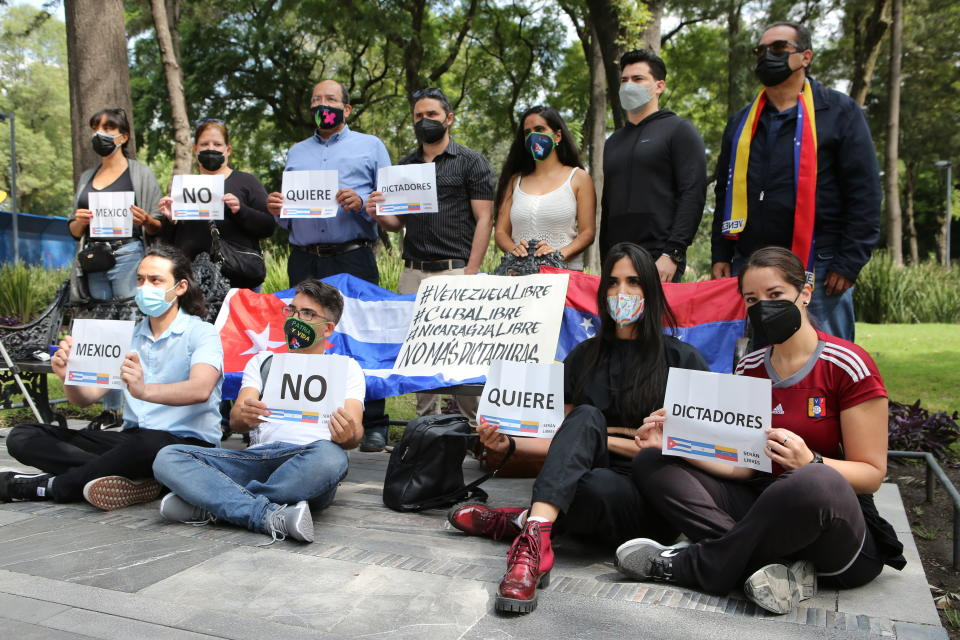 A small group gather in Alameda Park to protest against the participation of Venezuela's President Nicolas Maduro in the Community of Latin American and Caribbean States, CELAC, summit in Mexico City, Saturday, Sept. 18, 2021. CELAC has only existed for 10 years and is more left-leaning, having remained on good terms with countries including Cuba, Venezuela and Nicaragua. (AP Photo/Ginnette Riquelme)
