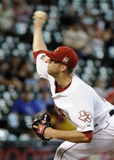 Houston Astros' Jordan Lyles delivers a pitch against the Kansas City Royals in the second inning of a baseball game Wednesday, June 20, 2012, in Houston. (AP Photo/Pat Sullivan)