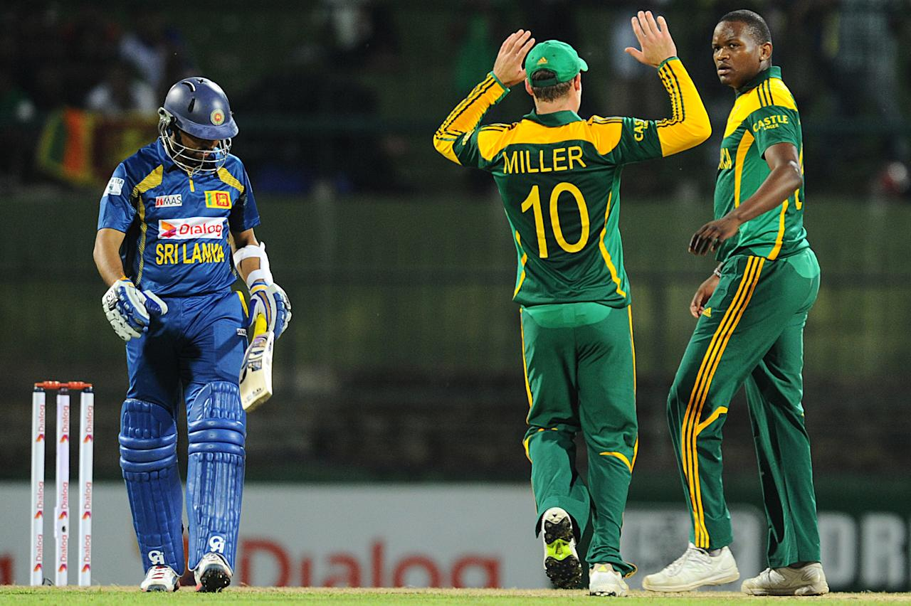 South African cricketers Lonwabo Tsotsobe (R) celebrates the wicket of  Sri Lankan cricketer Tillakaratne Dilshan (L) during the third One Day International (ODI) cricket match between Sri Lanka and South Africa at the Pallekele International Cricket Stadium in Pallekele on July 26, 2013. AFP PHOTO/ Ishara S.KODIKARA        (Photo credit should read Ishara S.KODIKARA/AFP/Getty Images)