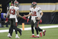 Tampa Bay Buccaneers quarterback Tom Brady (12) celebrates his touchdown with wide receiver Mike Evans (13) during the second half of an NFL divisional round playoff football game against the New Orleans Saints, Sunday, Jan. 17, 2021, in New Orleans. (AP Photo/Brett Duke)