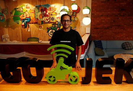 Nadiem Makarim, founder of the Indonesian ride-hailing and online payment firm Go-Jek poses for a photograph following an interview with Reuters at the Go-Jek offices in Jakarta, Indonesia, August 15, 2018. REUTERS/Darren Whiteside