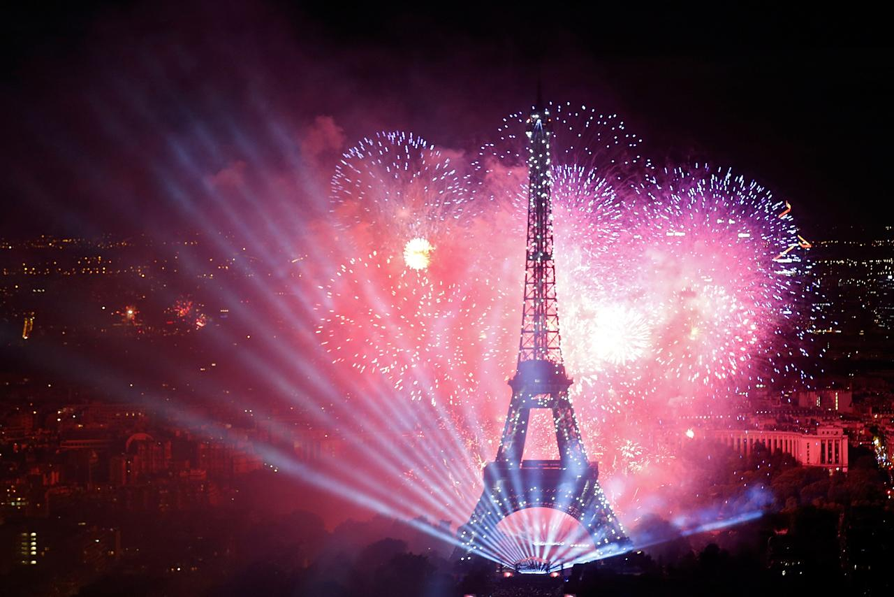 <p>Fireworks explode in the sky above the Eiffel Tower, in a picture taken from the Montparnasse Tower Observation Deck, at the end of Bastille Day events in Paris, France, July 14, 2017. (Photo: Pascal Rossignol/Reuters) </p>