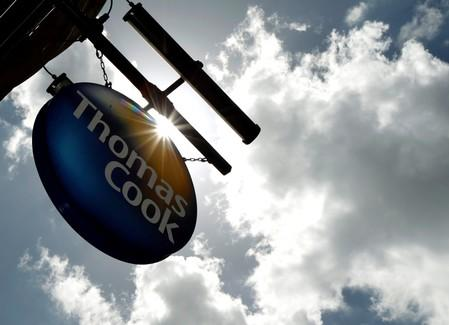 FILE PHOTO: A sign hangs in front of a branch of travel agent Thomas Cook in London