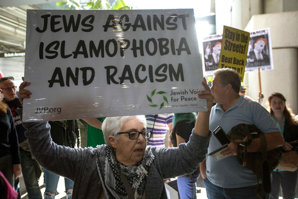 Demonstrators support a ruling by a federal judge in Seattle that grants a nationwide temporary restraining order against the presidential order to ban travel to the United States from seven Muslim-majority countries, at Tom Bradley International Terminal at Los Angeles International Airport on February 4, 2017 in Los Angeles, California.