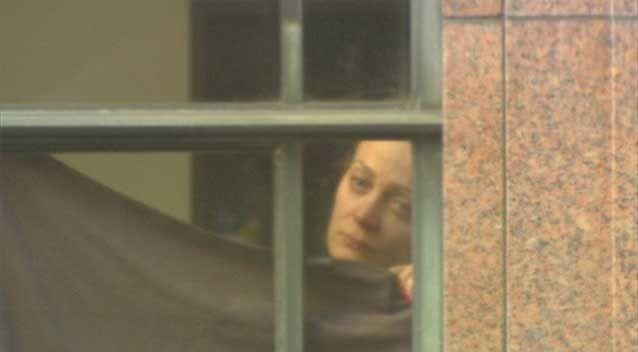 Hostage Marcia Mikhael was forced to stand in a window of the Lindt cafe during the siege. Photo: 7News