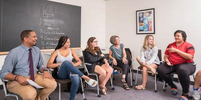 """Connecticut College Dean of Institutional Equity and Inclusion John McKnight (far left) sits with his first-year seminar students. The """"Conversations on Race"""" seminar is a part of The Agnes Gund '60 Dialogue Project at Connecticut College."""