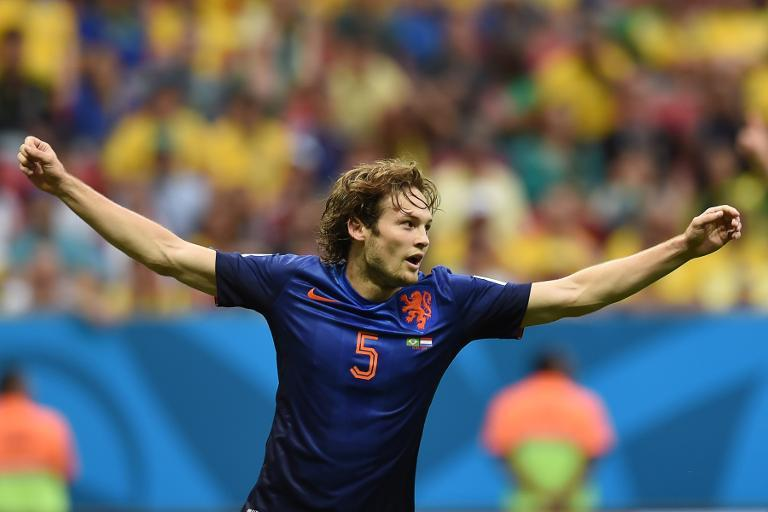 Netherlands defender Daley Blind celebrates after scoring against Brazil during the World Cup third place play-off at the National Stadium in Brasilia on July 12, 2014