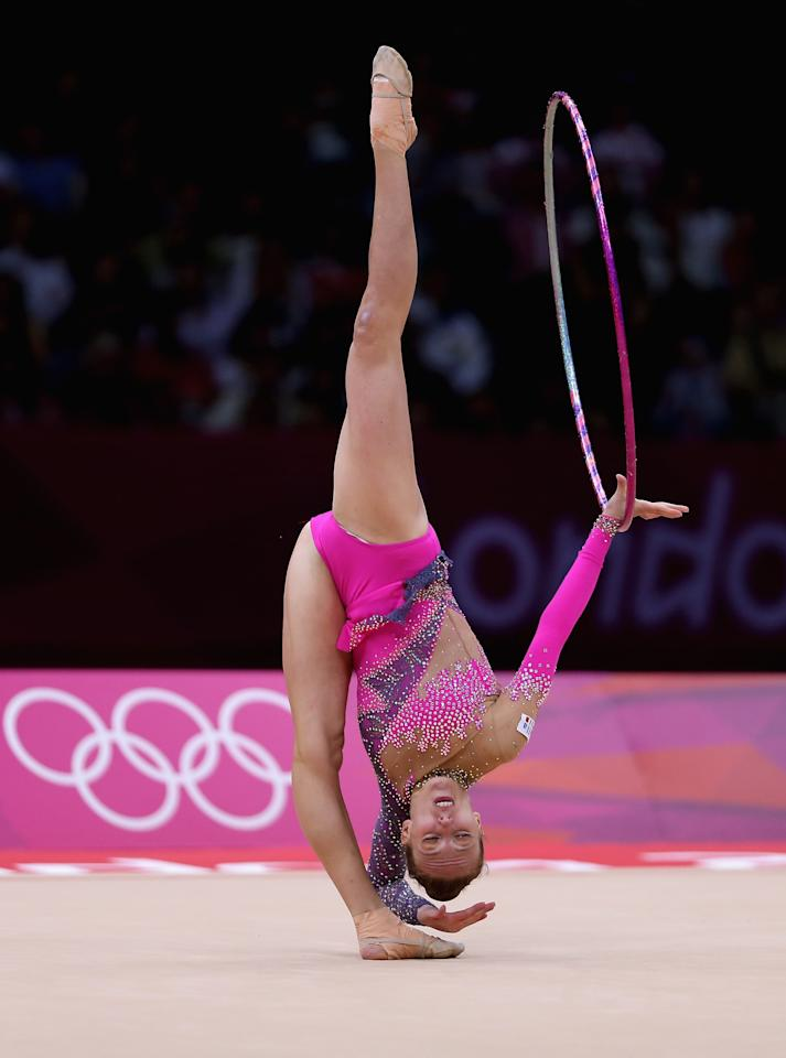 LONDON, ENGLAND - AUGUST 09:  Julieta Cantaluppi of Italy performs with the hoop during the Rhythmic Gymnastics qualification on Day 13 of the London 2012 Olympics Games at Wembley Arena on August 9, 2012 in London, England.  (Photo by Julian Finney/Getty Images)