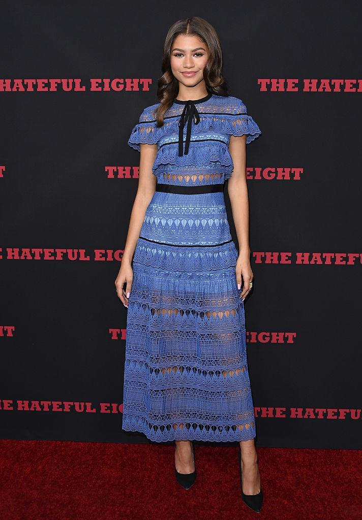 <p>Zendaya attended the premiere of 'Hateful Eight' in a blue lace gown by Self Portrait. <em>[Photo: Getty]</em> </p>