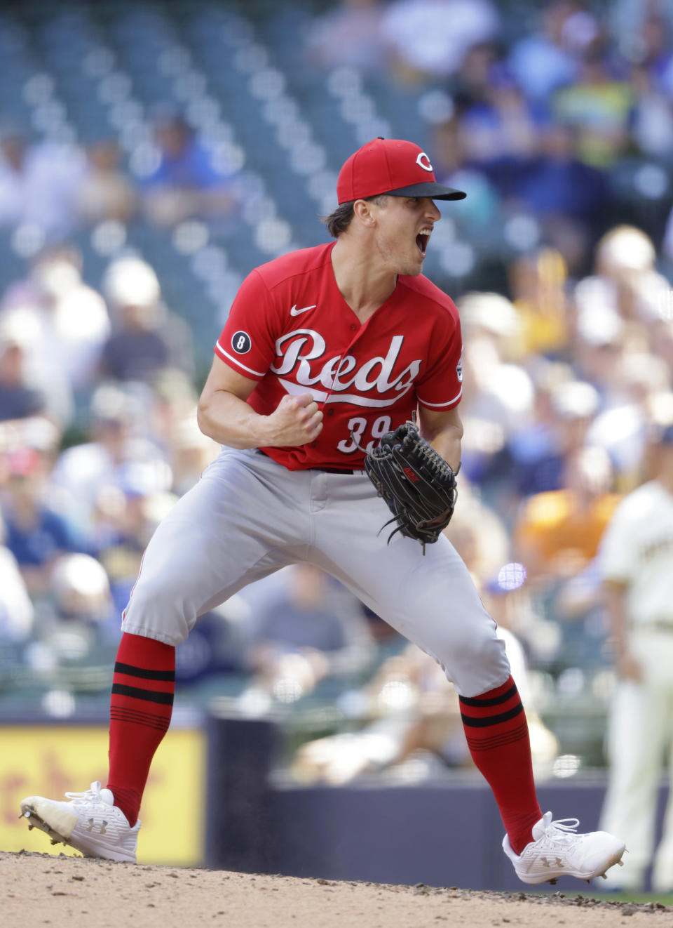 Cincinnati Reds pitcher Lucas Sims reacts after striking out Milwaukee Brewers Jackie Bradley Jr., to end the baseball game against the Milwaukee Brewers Wednesday, June 16, 2021, in Milwaukee. (AP Photo/Jeffrey Phelps)