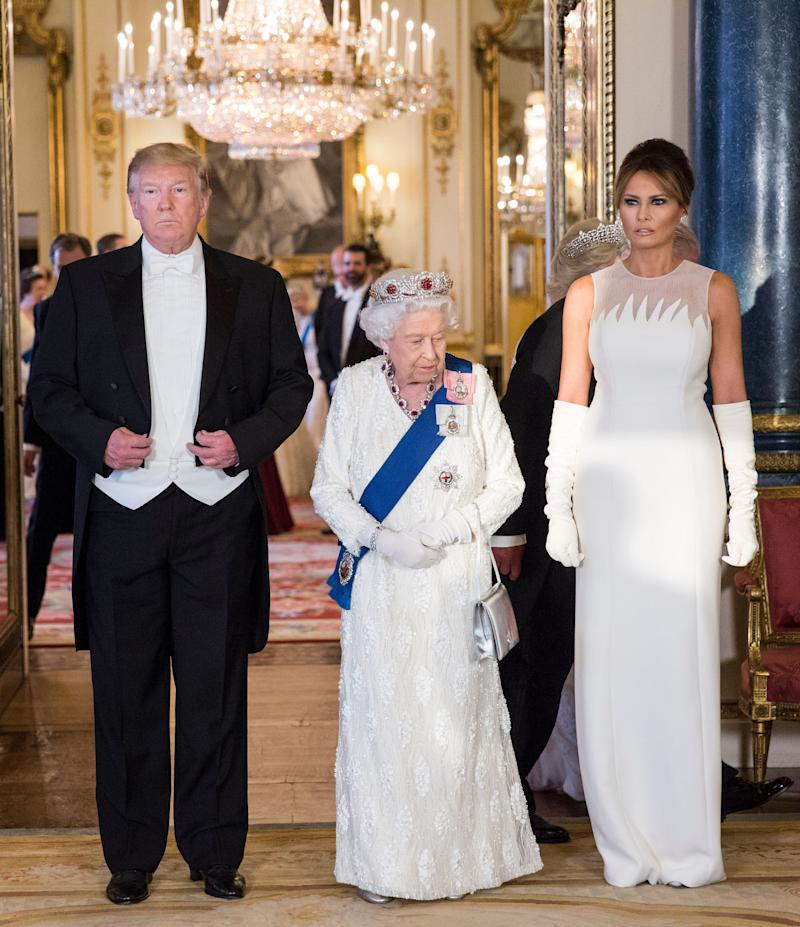 (left to right) US President Donald Trump, Queen Elizabeth II and Melania Trump, during a group photo ahead of the State Banquet at Buckingham Palace, London. [Photo: PA]