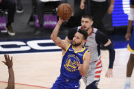 Golden State Warriors guard Stephen Curry (30) shoots during the second half of an NBA basketball game past Washington Wizards center Alex Len, back, Wednesday, April 21, 2021, in Washington. (AP Photo/Nick Wass)