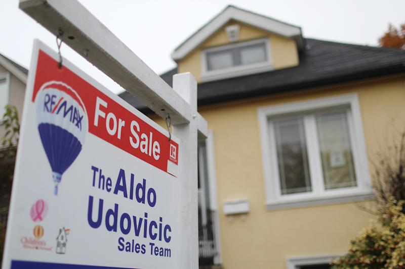 TORONTO, ON- A For Sale sign in front of an East York home in Toronto on Monday. Condo sales in the city inched the market up.(Rene Johnston/Toronto Star) (Rene Johnston/Toronto Star via Getty Images)