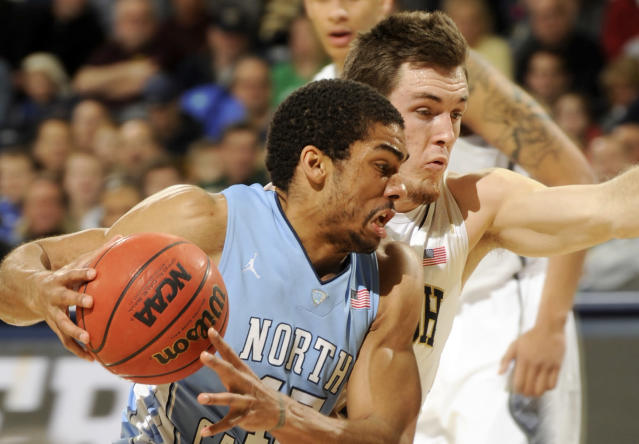 North Carolina forward J.P. Tokoto, left, drives the lane as Notre Dame guard Pat Connaughton defends during the first half of an NCAA college basketball game Saturday, Feb. 8, 2014, in South Bend, Ind. (AP Photo/Joe Raymond)