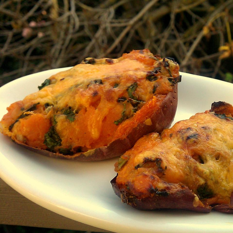 "<p>Not everyone wants a sugary-sweet side dish on their Thanksgiving plate, and this take is a good option for those who want to cut down on the amount of starch they're serving. Skip the mashed potatoes and go with this savory twice-baked sweet potato option instead. Save that sugar for dessert! <br><br><a href="" http://brokeassgourmet.com/articles/twice-baked-sweet-potatoes-with-kale-and-cheddar"" rel=""nofollow noopener"" target=""_blank"" data-ylk=""slk:Get the recipe"" class=""link rapid-noclick-resp"">Get the recipe</a> </p>"