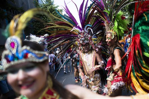A young dancer waits for the start of her dance group at the annual Carnival of Cultures parade in Berlin, Sunday, May 27, 2012. Thousands of people attended the festival with costumes from all over the world. (AP Photo/Markus Schreiber)