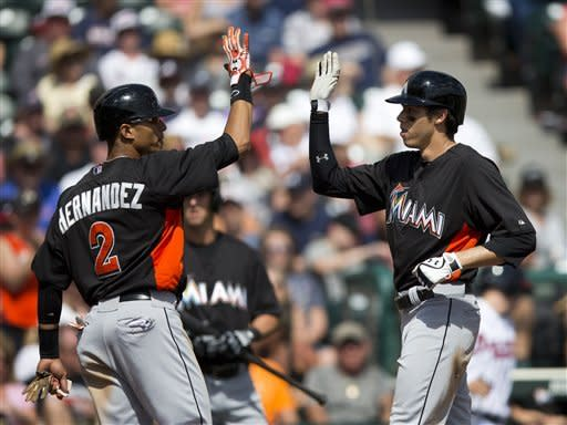 Miami Marlins' Gorkys Hernandez, left, congratulates teammate Christian Yelich after Yelich hit a two-run home run in the seventh inning of an exhibition spring training baseball game against the Atlanta Braves, Sunday, March 10, 2013, in Kissimmee, Fla. (AP Photo/Evan Vucci)