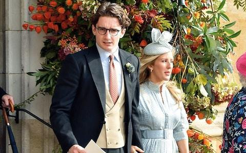 Ellie at Princess Eugenie's wedding with her fiancé, Caspar Jopling, last year - Credit: getty images