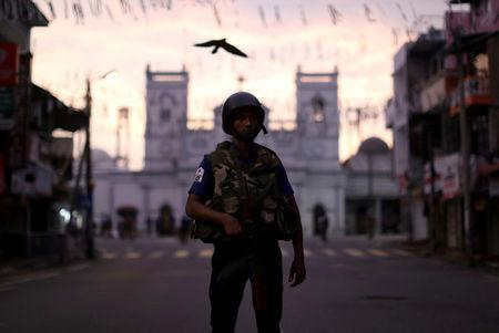 A security officer stands guard outside St. Anthony's Shrine in Colombo