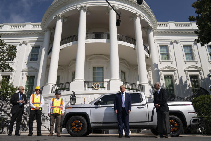 Lordstown Motors CEO Steve Burns shows President Donald Trump the Endurance all-electric pickup truck, made in Lordstown, Ohio, at the White House, Monday, Sept. 28, 2020, in Washington. (AP Photo/Evan Vucci)