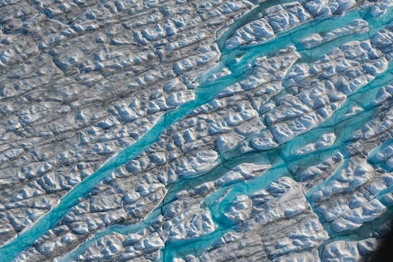 In this view from an airplane rivers of meltwater carve into the Greenland ice sheet near Sermeq Avangnardleq glacier near Ilulissat, Greenland. (Photo: Sean Gallup/Getty Images)