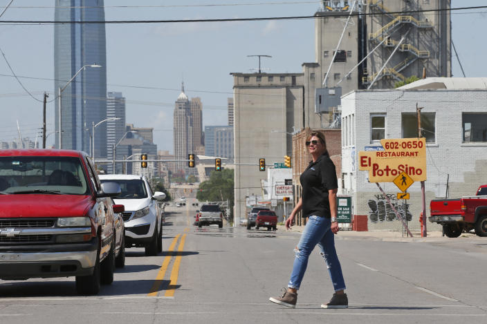 Teresa Stanfield, the Oklahoma field director with Virginia-based Prison Fellowship, walks on the south side of town Tuesday, Aug. 11, 2020, as she is videotaped in Oklahoma City. Normally, Stanfield is behind bars, talking with inmates about how she changed the course of her troubled life. The coronavirus has forced her out of prisons. For the time being, Stanfield is videotaping her message. (AP Photo/Sue Ogrocki)