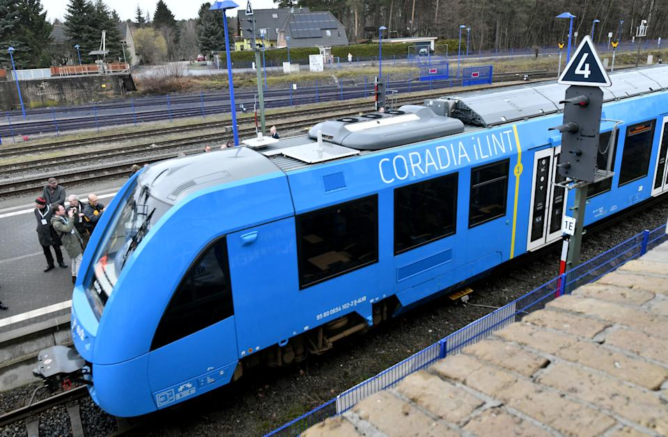 11 February 2019, Brandenburg, Basdorf: The Coradia iLint, the world's first hydrogen multiple-unit train for the regional traffic of the French train manufacturer Alstom, is located in Basdorf railway station; the gas tanks can be seen on the roof. The Heidekrautbahn wants to be more environmentally friendly. Niederbarnimer Eisenbahn AG (NEB) plans to deploy 27 hydrogen trains on its RB line from 2022. Photo: Bernd Settnik/dpa-Zentralbild/ZB (Photo by Bernd Settnik/picture alliance via Getty Images)