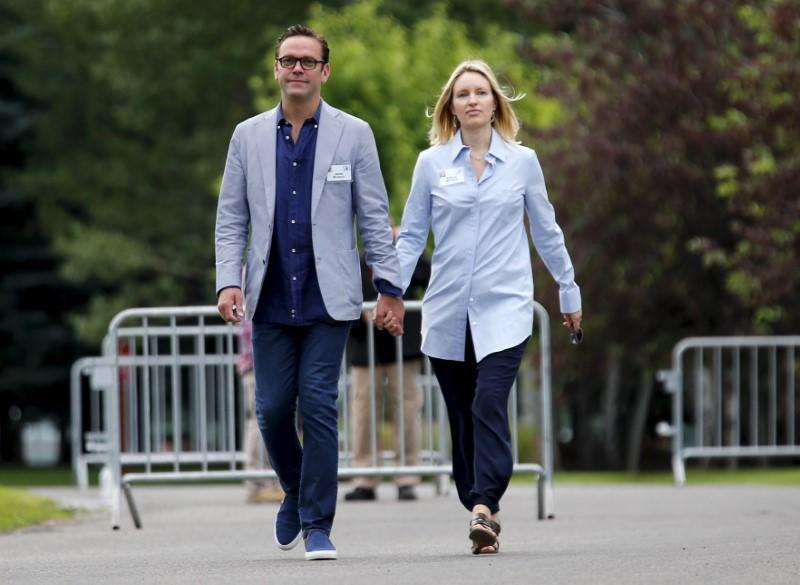 21st Century Fox CEO James Murdoch walks with his wife as they arrive for the first day of the annual Allen and Co. media conference in Sun Valley