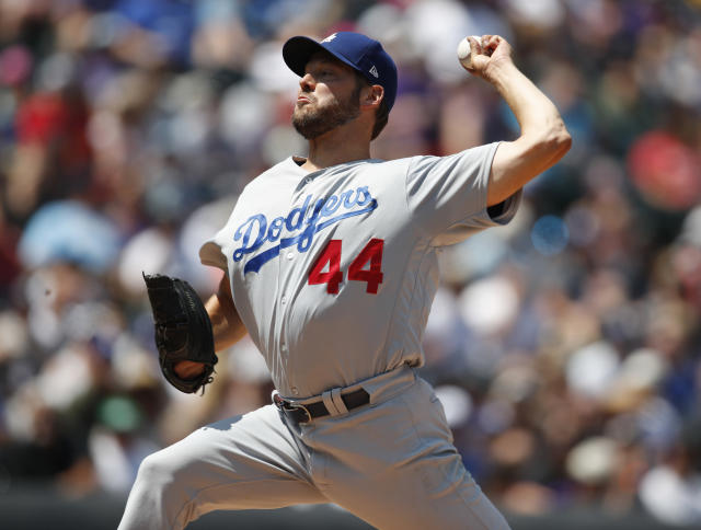 Los Angeles Dodgers starting pitcher Rich Hill works against the Colorado Rockies in the first inning of a baseball game Sunday, Aug. 12, 2018, in Denver. (AP Photo/David Zalubowski)