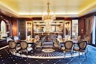 <p>The dining room seats 20 and features custom carpeting.</p> <p>(Sotheby's International Realty Canada)</p>