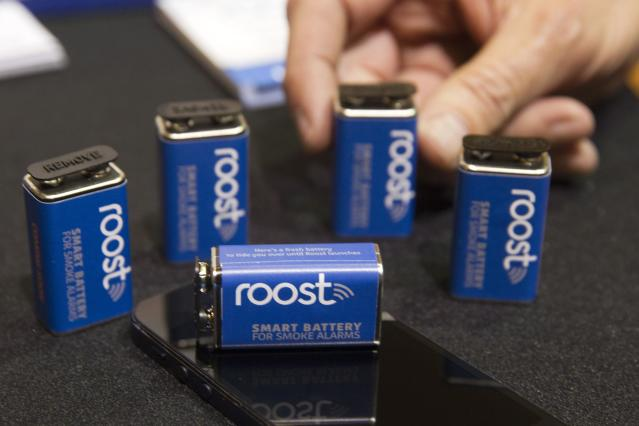 Batteries are shown in a Roost booth during the 2015 International Consumer Electronics Show (CES) in Las Vegas, Nevada January 4, 2015. The wi-fi enabled replacement batteries for smoke detectors will be able send you a notification if the smoke alarm goes off when you are away and alert the owner when the battery is close to running out. The batteries are expected to be available in the summer of 2015, a representative said. REUTERS/Steve Marcus (UNITED STATES - Tags: SCIENCE TECHNOLOGY BUSINESS ENERGY)