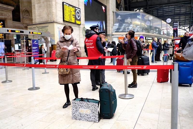 Passengers wait at Milan's main railway station, on February 25, 2020, following security measures taken in northern Italy against the COVID-19 the novel coronavirus. - Italy reported on February 24, 2020 its fourth death from the new coronavirus, an 84-year old man in the northern Lombardy region, as the number of people contracting the virus continued to mount. (Photo by ANDREAS SOLARO / AFP) (Photo by ANDREAS SOLARO/AFP via Getty Images) (Photo: ANDREAS SOLARO via Getty Images)